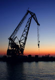 Sea and crane. Evening landscape with sea and crane Royalty Free Stock Photography