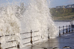 Sea crashing over railings. At the North Bay Scarborough, Yorkshire Stock Photo