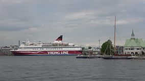 Sea cruise ferry `Gabriella` in the harbour of Helsinki on a cloudy day. Finland stock video