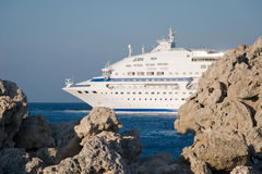 Sea cruise liner in rocks Stock Photography