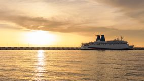 Sea cruise ship moored in the harbor at sunset stock photo