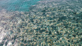 Sea Crystal Clear Blue Water Background. Sea crystal clear water background. Clear water at the shore of the Red Sea. Light waves of crystal clear water stock video footage