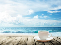 Sea and cup of coffee Stock Image