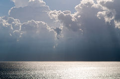 Sea and dark clouds Royalty Free Stock Images