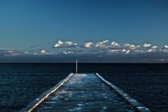 Sea deck. Centered old deck in the sea stock photography