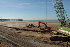 Sea defences. Construction machines prepare improvements to Lancashire's sea defences Stock Photo