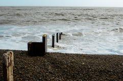 Sea defences on the coast. Coastal sea defences and groynes on a East Coast beach, UK Royalty Free Stock Photo