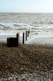 Sea defences on the coast. Coastal sea defences and groynes on a East Coast beach, UK Stock Photography