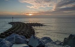 Sea defences at Ipswich at sunrise. stock photos