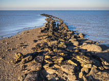 Sea defences, Kent. Hampton pier sea defences, near Herne Bay and Whitstable, Kent, UK. The Kentish Flats wind farm can be seen on the horizon Royalty Free Stock Photo