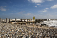 Sea Defences on Lowestoft Beach, Suffolk, England. Against a blue sky Stock Photography