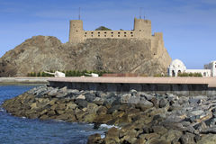 Sea defences at the Sultan's Palace complex with Al-Jalali fort Royalty Free Stock Image