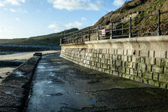 Sea defences and walkways. Sea defences and promenades at a coastal resort showing brick and concrete work with railings Royalty Free Stock Image