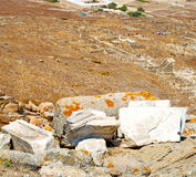 Sea in delos greece the historycal acropolis and old ruin site Stock Photo
