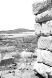 Sea in delos greece the historycal acropolis and old ruin site Royalty Free Stock Photos