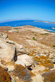 Sea in delos greece the historycal acropolis and old ruin site Stock Photography