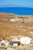 Sea in delos greece the historycal acropolis and old ruin site Stock Image