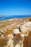 Sea in delos greece the historycal. In delos greece the historycal    acropolis and old ruin site Royalty Free Stock Photos
