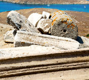 Sea in delos greece the historycal acropolis and old ruin site. In delos greece the historycal    acropolis and old ruin site Royalty Free Stock Photo