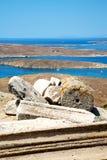Sea in delos greece the historycal  site. In delos greece the historycal    acropolis and old ruin site Stock Photo