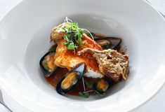 Sea devil with mussels. On a plate stock photos