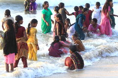 Women swimming. Women bathing themselves while fully dressed in India Royalty Free Stock Photos