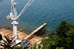 Sea and dock. Summer quiet seaside cargo terminal Stock Image