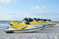 Sea-Doo Personal Water Craft on Tropical Beach. Sea-Doo Personal Watercrafts on a Tropical Beach on a Sunny Morning at a Resort in Mexico's Riviera Maya on March Stock Photo