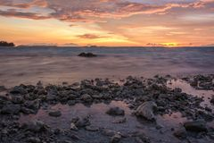 The sea and the dramatic twilight sky on rocky beach stock photos