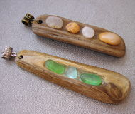 Sea driftwood pendants Stock Image