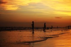 The sea at dusk reflects the yellow light royalty free stock photo
