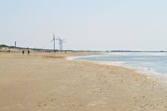 Sea and energy wind mills, Holland Royalty Free Stock Image
