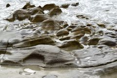 Sea eroded rocks Stock Photos