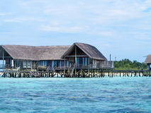 Sea facing cottages on maldive island Stock Images