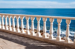 Sea and fence with white balusters Royalty Free Stock Image