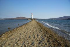 In the sea filled the road to the lighthouse, in the middle of the Sea Beach line passes. The beautiful sea Royalty Free Stock Images