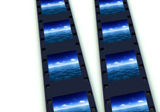 Sea And Film 5. A few developed frames of celluloid film Royalty Free Stock Photo