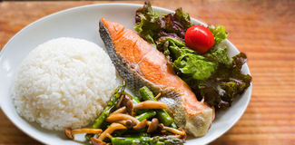 Sea Fish Fried ,white rice,fried vegetables and vegetable salad Royalty Free Stock Images
