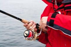 Sea fisherman in red Stock Image