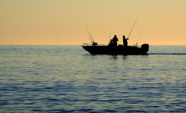 Sea fishermen silhouette Stock Photo