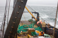 Sea fishery - trawler prepares for throw  of snurrevaad (Danish seine, seine net) in Royalty Free Stock Images
