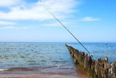 Sea fishing. Relax time on the beach Stock Image