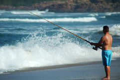 Sea fishing. Beach fishing in the ocean Royalty Free Stock Photo