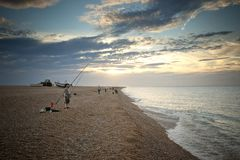 Sea Fishing and Angling on the beach at Cley-next-the-Sea, North Norfolk, UK - August 2012 stock photography