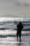 Sea fishing from beach at Harlech, Wales Stock Image