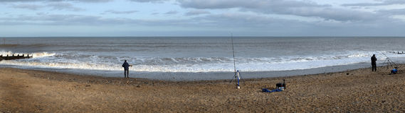 Sea fishing from the beach. Royalty Free Stock Image