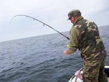 Sea fishing from boat stock photo