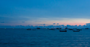 Sea and Fishing boat. Fishing boat was moored Sea with Sunset Stock Images