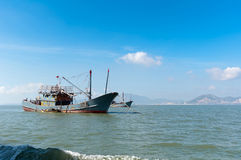 The sea and fishing boats. Blue sky and sea and fishing boats Royalty Free Stock Photography