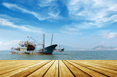 The sea and fishing boats. Blue sky and sea and fishing boats Royalty Free Stock Image